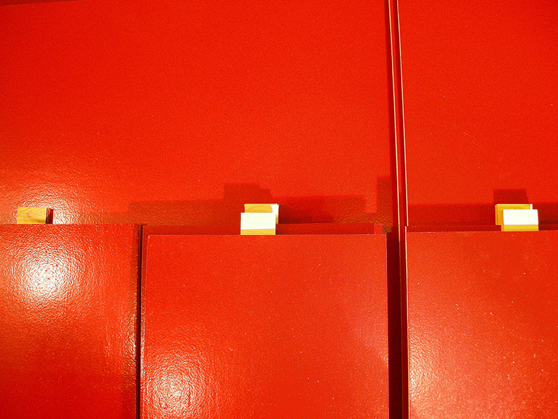 Red wall image from SET THE CONTROLS FOR THE HEART OF THE SUN, installation at WRKS DVSN, by Kennedy Telford, 2006.