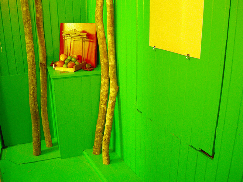 Green walls and shrine image from SET THE CONTROLS FOR THE HEART OF THE SUN, installation at WRKS DVSN, by Kennedy Telford, 2006.