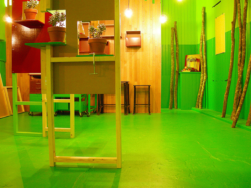 Jade plants set into the red and green room divider, image from SET THE CONTROLS FOR THE HEART OF THE SUN, installation at WRKS DVSN, by Kennedy Telford, 2006.